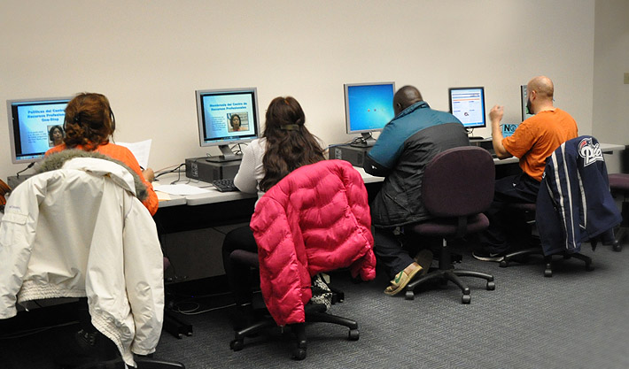 Job seekers using computer in the resource room.