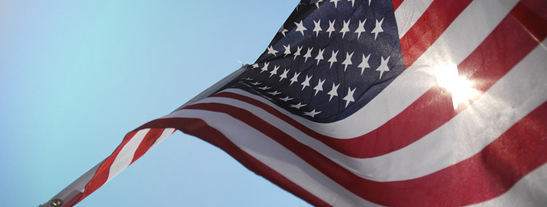American flag flying in the sky.