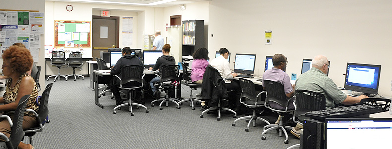 People working on computers in our resource room.